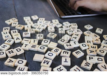 Blurred Text Dice Cube Background. Abstract Blur. Text Dice Cube Concept / Letter Dices Alphabet On