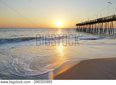 Avalon Pier And Sandy Beach At The Outer Banks Of North Carolina At Sunrise