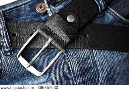 Black Leather Belt On Denim. Jeans Belt. Fastened Fashionable Men\'s Leather Belt With Dark Matted M