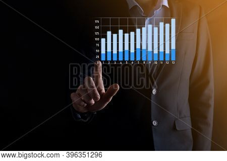 Business Man Holding Holographic Graphs And Stock Market Statistics Gain Profits. Concept Of Growth