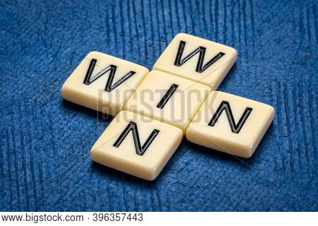 win-win crossword in ivory letter tiles against textured handmade paper, strategy, business, negotiation, cooperation and solution concept