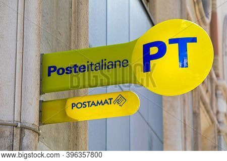 Trieste, Italy - March 7, 2020: Yellow Sign Poste Italiane At Post Office In Trieste, Italy.
