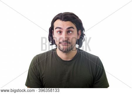 Portrait Of Silly Young Man, Curly Hair Style, Makes Funny Dumb Faces With Crossed Eyes. Body Langua