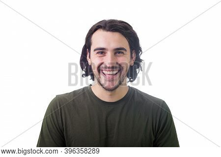 Portrait Of Smiling Brunette Young Man, Long Curly Hair Style, Looking Joyful And Laughing To Camera