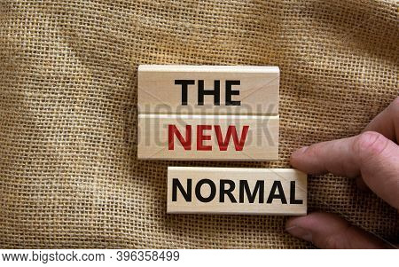 The New Normal Concept. Wooden Blocks With Words 'the New Normal'. Beautiful Canvas Background, Male