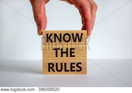 Know The Rules. Wooden Blocks Tower With Words 'know The Rules', Male Hand. Beautiful White Backgrou