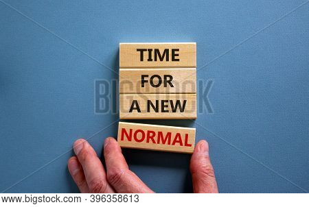 Time For A New Normal. Wooden Blocks With Words 'time For A New Normal'. Male Hand. Beautiful Blue B
