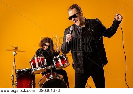 Photo Of Popular Rock Group Redhair Lady Plays Instruments Beat Drum Sticks Vocalist Guy Sings Mic C