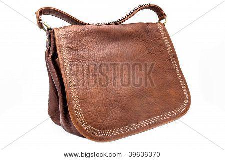 A leathern handbag on a white background
