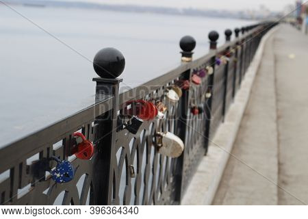 Locks On The Fence Of The Bridge. Lovers Lock Their Love With The Lock.