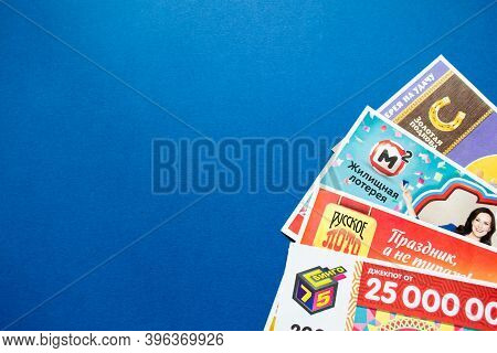 Moscow, Russia, July 2020: Various Russian Lottery Tickets On A Blue Background. Russian Lotto.