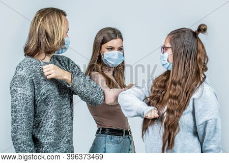 Elbows Bump. Friends Wearing Protective Face Mask And Greeting Each Other With The Elbow. People Fri