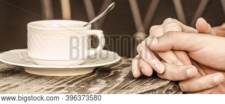 Couple Enjoying Coffe. Lovely Couple Holding Cup Of Coffe In Hands. Female And Man Hands Holding Cup