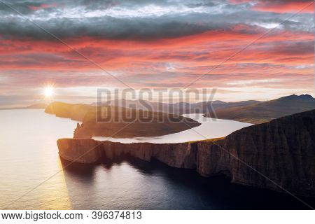 Incredible panoramical view of Sorvagsvatn lake on cliffs of Vagar island in sunset time, Faroe Islands, Denmark. Landscape photography