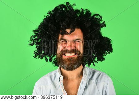 Man In Wig. Smiling Man In Curly Wig. Happy Man In Color Wig. Smile. Close Up Portrait Of Smiling Be