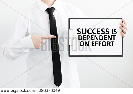 White Sheet On The Tablet With Text Success Is Dependent On Effort In Male Hands On A Light Backgrou