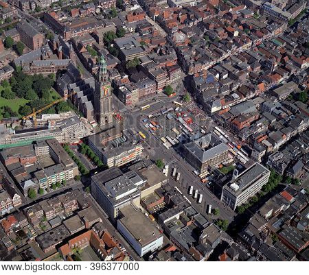 Groningen, Holland, July 12 - 1990: Historical aerial photo of Groningen with in the center the Martinitoren at the grote Markt, Holland