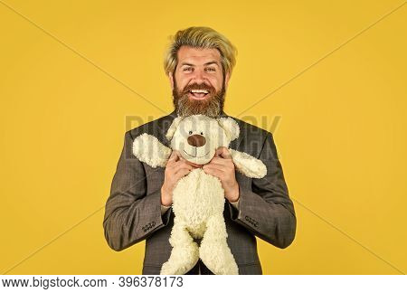 Still Childish In Soul. Happy Businessman Hug Teddy Bear Yellow Background. Bearded Man With Toy Fri