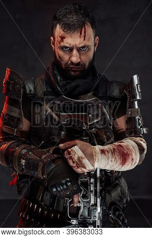 Portrait Of Staring At Camera With Serious Face Stalker With Damaged And Bandaged Arm Holds His Shot