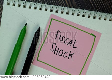 Fiscal Shock Write On Sticky Notes Isolated On Wooden Table.