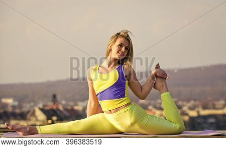 Flexible Girl Outdoor. Attractive Woman Practicing Yoga. Splits Exercise. Workout For Gymnastic Spli