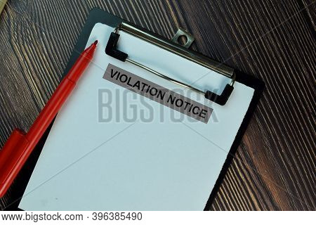 Violation Notice Write On A Paperwork Isolated On Wooden Table.