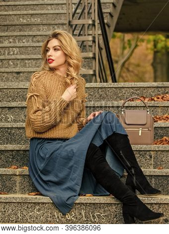 Layer Oversize Knit Over Girly Skirt. Wearable Trends. Fall Outfit Formula. How To Style Sweater And