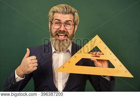 Mathematics Favorite Subject. Man Teacher Use Math Rule Tool. Bearded Tutor At Chalkboard. Mathemati