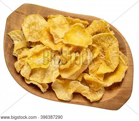 Dried slices of yacon tuber, top view of isolated wooden bowl. Yacon contains inulin, a complex sugar, which promotes healthy probiotics. Superfood concept.
