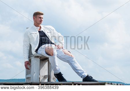 Relaxed Sexy Look. Sexy Man Sit On Chair Cloudy Sky. Handsome Guy Wear Casual Style Outdoors. Fashio