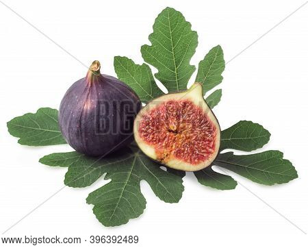 Whole And Half Figs With Leaves Isolated