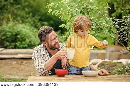Healthy Food Concept. Father Son Eat Food And Have Fun. Menu For Children. Family Enjoy Homemade Mea