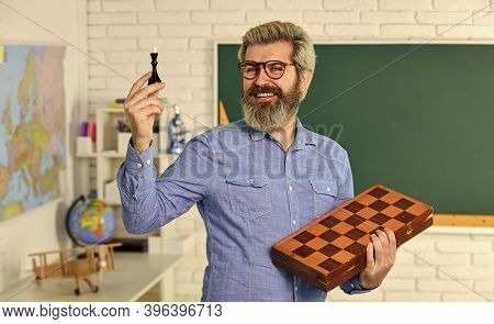 Board Game. Smart Man Playing Chess. Intellectual Hobby. Every Chess Master Was Once Beginner. Chess