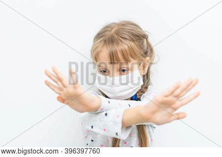 Covid-19 And Air Pollution Pm2.5 Concept. Little Girl Wearing Mask For Protect Pm2.5 And Hands Gestu