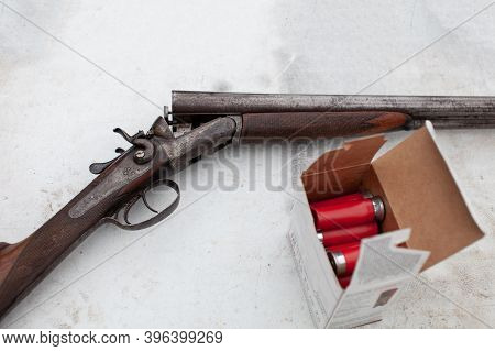An Old, Vintage, Break-action Double-barrel Shotgun Featuring Two Triggers And Two Hammers. Placed O