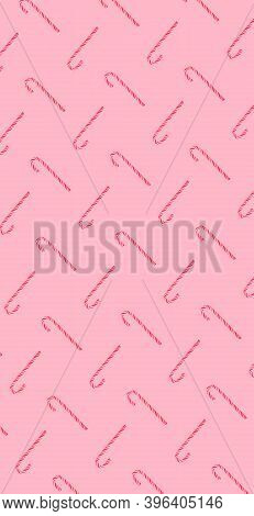 Traditional Christmas Candy Cane On Pink Background