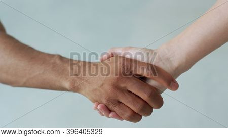 White And Black Hand Connect. Anti-racism. Stop Racism, All People Are Equal. Friendship Of Peoples.
