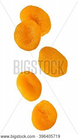 Dried Apricot Fruits Isolated In The Air On White Background