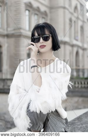 Woman With Red Lips And Brunette Hair In Paris, France. Girl In Sunglasses Pose On House Facade. Fas