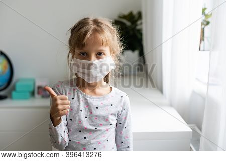 Covid-19 And Air Pollution Pm2.5 Concept. Little Girl Wearing Mask For Protect Pm2.5 And Ok Finger H