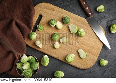 Fresh Brussels Sprouts On Black Slate Table, Flat Lay