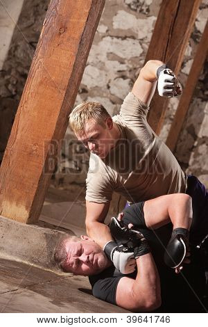 Mma Fighter Beating Opponent