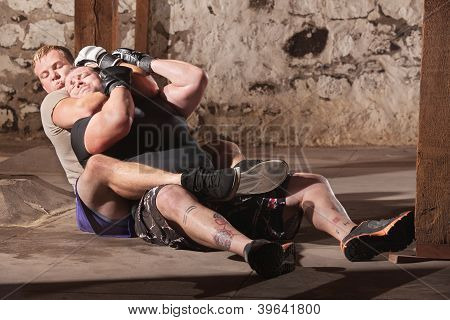 Mma Fighters In Choke Hold Training