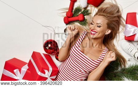 Sporty Young Blonde Woman With Perfect Body Lying On Floor In Fashion Body Cloth Happy Laughing With