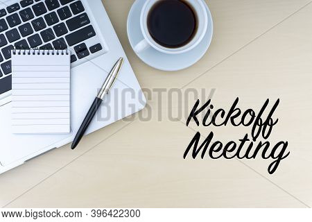 Kickoff Meeting Text With Fountain Pen, Notepad, Laptop And Cup Of Coffee On Wooden Background. Busi