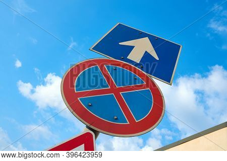 One way street and no stopping traffic sign from low angle