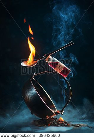 Cauldron, Fire Potion And A Spoon With Flame In A Balancing Composition With Smoke, Fantasy Book Cov
