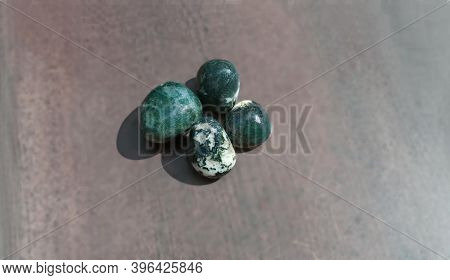 Moss Agates, Polished Tumbled Stones. Green Colour Stones With Patches Of White In Between Form Of S