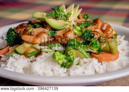 Exquisite Shrimp Teriyaki With Broccoli, Pumpkin, Carrot And Rice Bathed In Oyster Sauce On A White