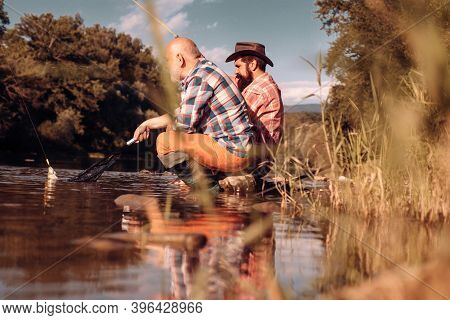 Young Man Fishing. Retirement Fishery. Relax On Nature. Happy Bearded Fisher In Water. Start Living.